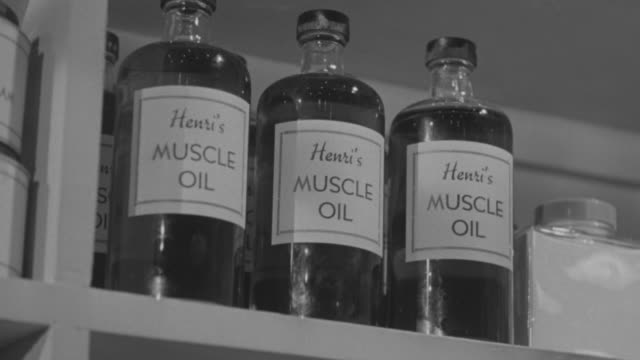 ms la shot of muscle oil bottle in hospital - body building stock videos & royalty-free footage