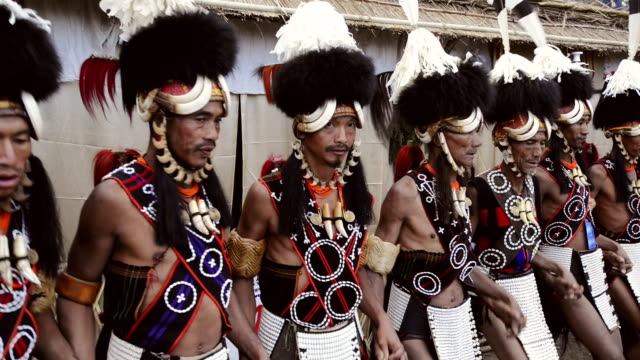 MS Shot of Naga tribesmen dancing in Hornbill Festival at Kisama AUDIO / Kohima, Nagaland, India
