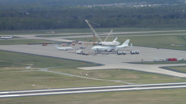 ws shot of nasa shuttle carrier aircraft with space shuttle discovery on ground at dulles airport / sterling, virginia, united states - space shuttle discovery stock videos & royalty-free footage