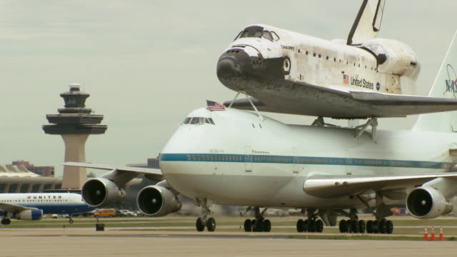 ms zi shot of nasa shuttle carrier aircraft with space shuttle discovery taxing at dulles airport / sterling, virginia, united states - space shuttle discovery stock videos & royalty-free footage