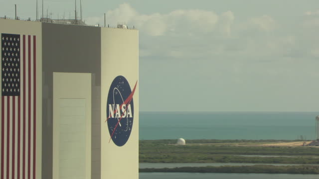MS AERIAL Shot of NASA sign on Launch Pad 39A building at Kennedy Space Center / Florida, United States
