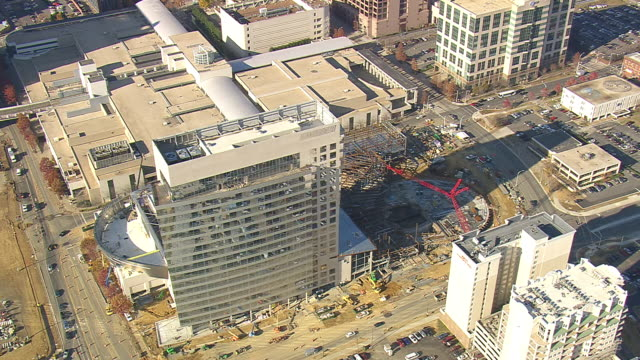 ms aerial ds zi shot of nascar hall of fame building / north carolina, united states - fame stock videos and b-roll footage