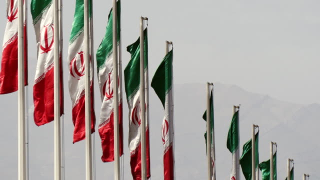 ms shot of national flags of iran / tehran, iran  - イラン点の映像素材/bロール