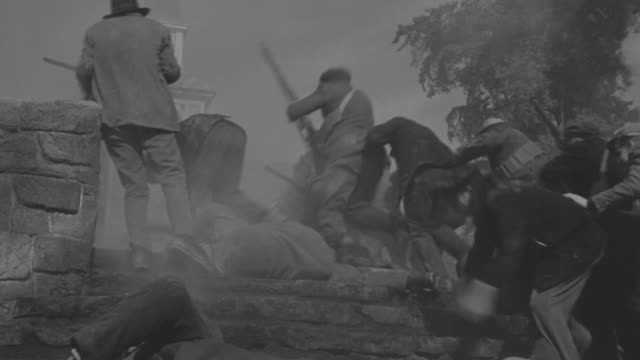 MS Shot of Nazi soldiers firing on town people in battle