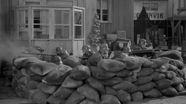 ms shot of nazi soldiers in sandbag nest shooting machine guns - gun stock videos and b-roll footage
