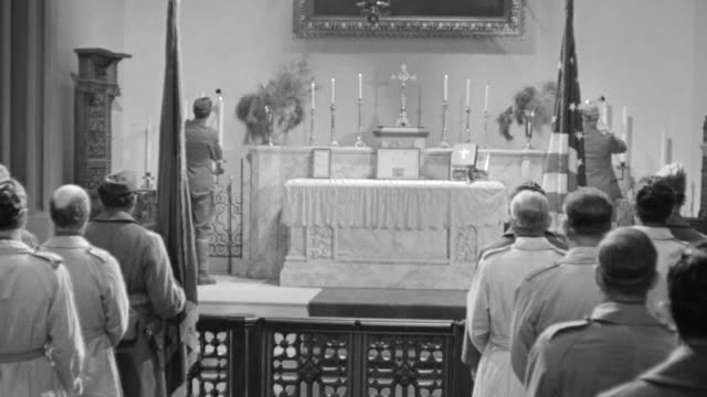 MS Shot of Nazi soldiers lighting candles in church