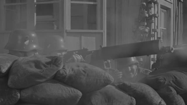 cu shot of nazis in machine gun nest during battle with small town background and soldiers behind wall of sand bags - gun stock videos & royalty-free footage