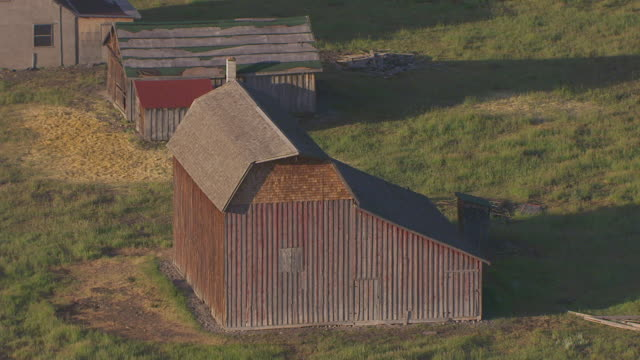 cu aerial ts zo shot of neighboring barn and pull back to reveal entire barn / wyoming, united states - jackson hole stock-videos und b-roll-filmmaterial