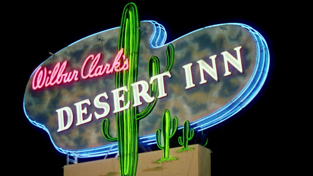 ms shot of neon sign that road wilbur clarks desert inn - inn stock videos and b-roll footage