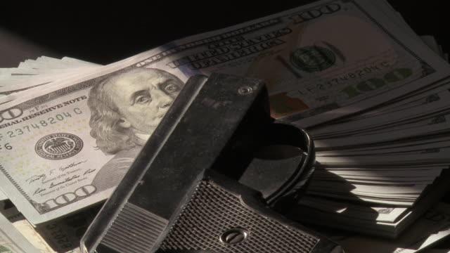 CU TU Shot of New 100 Dollar bill with 6mm gun / Frankfurt, Hessse, Germany