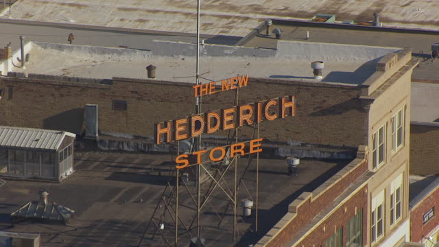 cu aerial ts zo shot of new hedderich store sign and pull out to downtown / williston, north dakota, united states - store sign stock videos & royalty-free footage