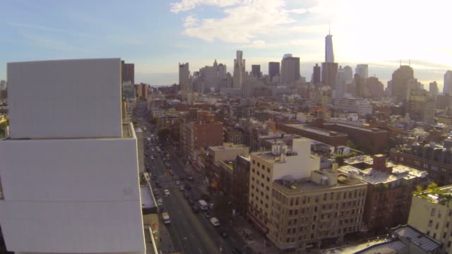 ms aerial slo mo tu shot of new museum with traffic moving on street at sun setting / new york, united states - urban road stock videos & royalty-free footage