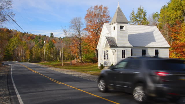ws shot of newry community church 1904 in northern new england in fall foliage in october with car traveling on road / newry, maine, united states - 1904 stock videos & royalty-free footage
