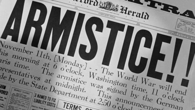 "cu shot of newspaper headline ""armistice"" - the end stock videos & royalty-free footage"