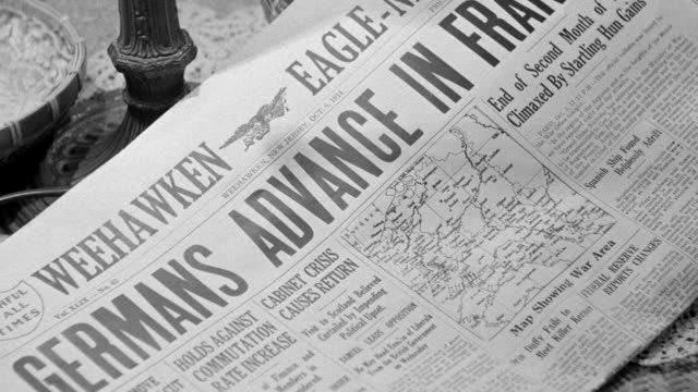 "CU Shot of Newspaper headline ""Germans Advance In France"""