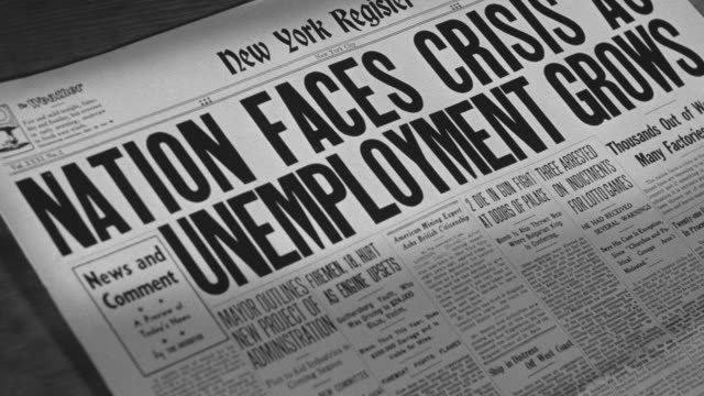 "CU Shot of Newspaper headline ""Unemployment Grows"""