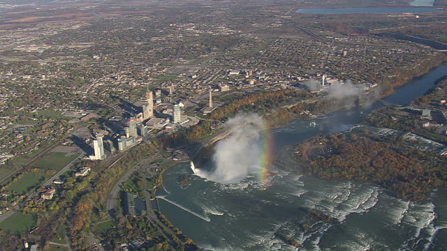 ms aerial pan zi shot of niagara falls (2,500ft) with rainbow / new york, united states - niagara falls stock videos & royalty-free footage