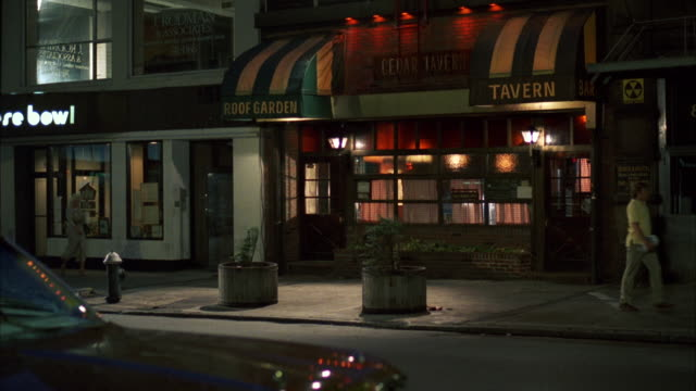 stockvideo's en b-roll-footage met ms shot of nice bar or tavern cedar's tavern, dusk shot with wet street - bar gebouw