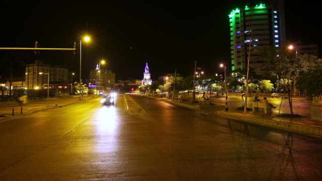 MS T/L Shot of nigh traffic at crossroads / Cartagena, Colombia