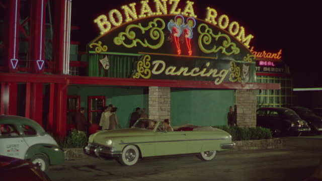 ms td shot of night club exterior, bonanza room - entrance sign stock videos & royalty-free footage