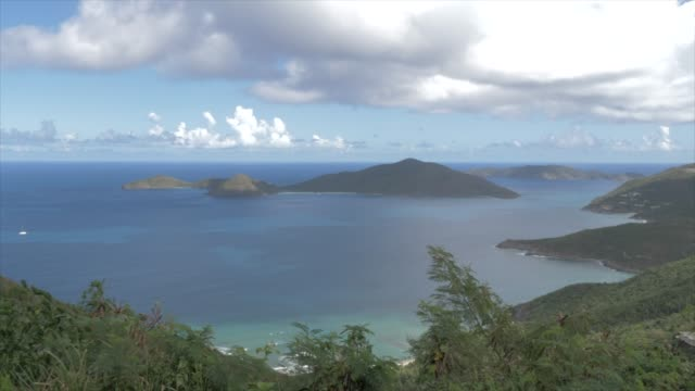 shot of north of tortola from ridge road with views of guana island, tortola, british virgin islands, west indies, caribbean, central america - クレーンショット点の映像素材/bロール