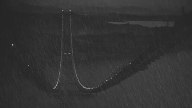 WS Shot of  oakland bay bridge under construction at night in rain