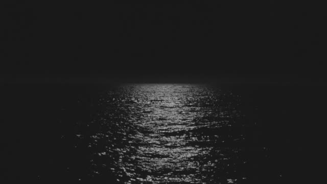 ms shot of ocean with moon path reflecting off water at night - seascape stock videos & royalty-free footage