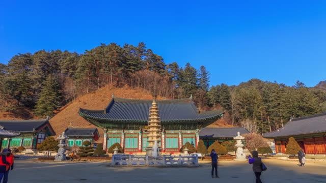 shot of octagonal nine story stone pagoda(korea national treasure 48) at woljeongsa temple in odaesan national park - besichtigung stock-videos und b-roll-filmmaterial