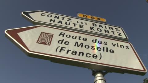 cu shot of of traffic signs / contz-les-bains, lorraine, france - lorraine stock-videos und b-roll-filmmaterial