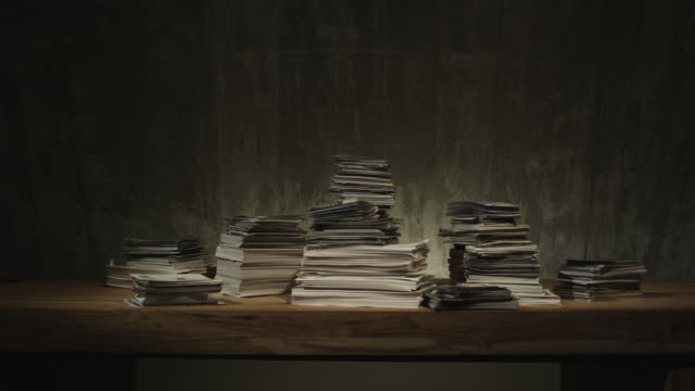 shot of office documents on a desk - stack点の映像素材/bロール