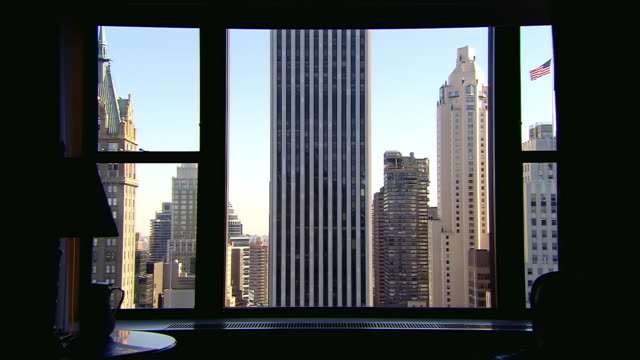 MS Shot of Office interior looking out of window to other office buildings / New York, United States