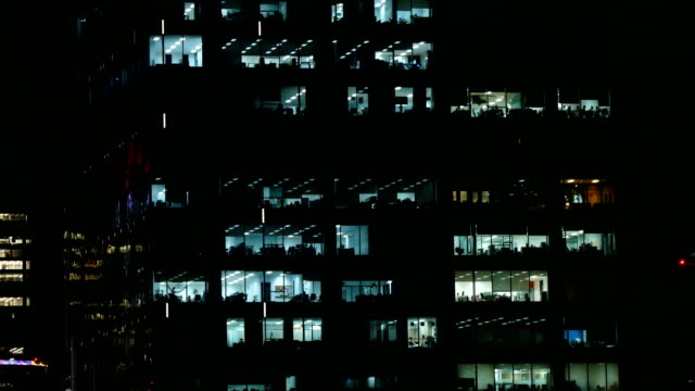 MS Shot of office workers working late in multi story building
