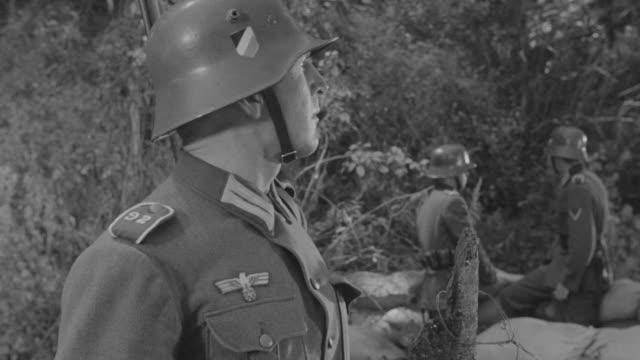 ms shot of officer watching and nazi soldier hiding behind sand bags - officer militär grad bildbanksvideor och videomaterial från bakom kulisserna