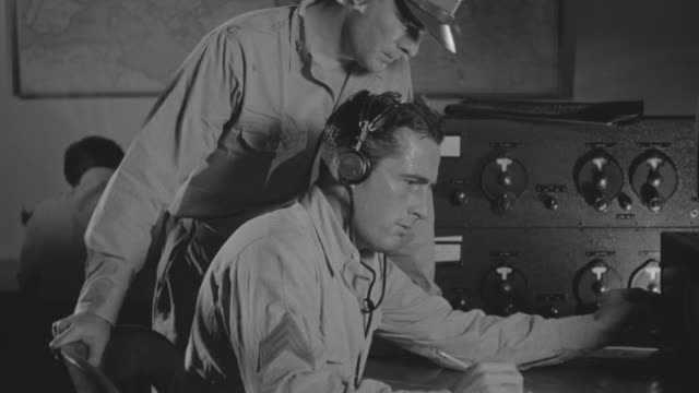 ms zo shot of officer working at control room - telegraf stock-videos und b-roll-filmmaterial