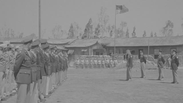 MS Shot of Officers and Soldiers lined up on airfield