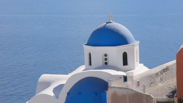 ms shot of oia cyclades blue church dome and greek islands beautiful peaceful place / santorini, greece - oia santorini stock videos & royalty-free footage