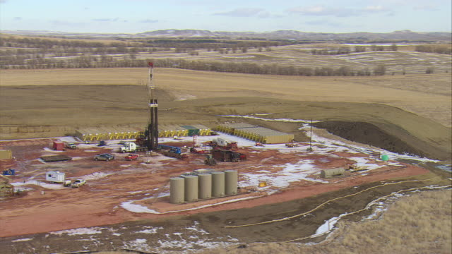 WS AERIAL DS Shot of oil drilling rig in Bakken oil field near Watford City / Watford City, North Dakota, United States