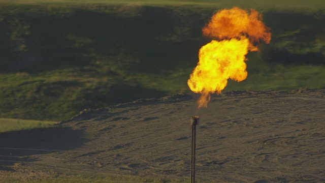 CU AERIAL TS Shot of Oil well and gas flare burns at Williston Basin / North Dakota, United States