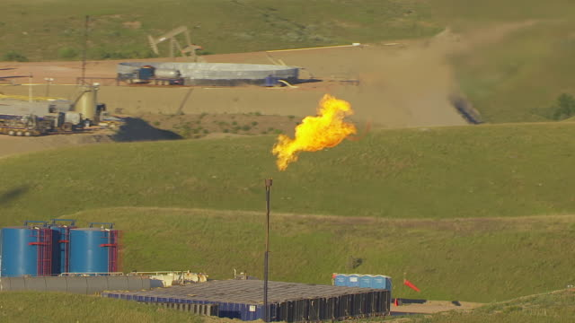 MS AERIAL TS ZI Shot of Oil well and gas flare burns at Williston Basin / North Dakota, United States