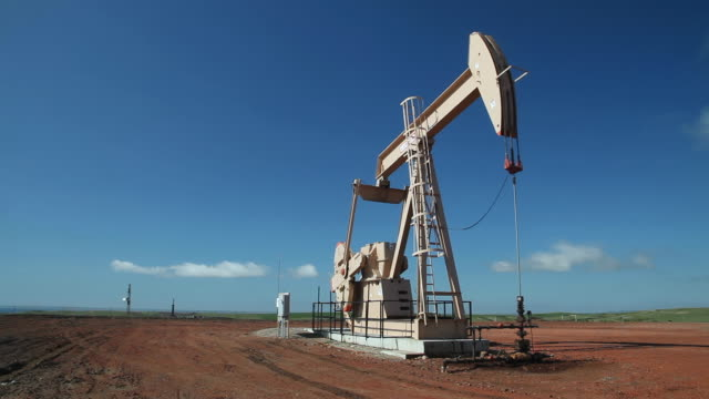 MS Shot of Oil wells on Bakken deposit / New Town, North Dakota, United States