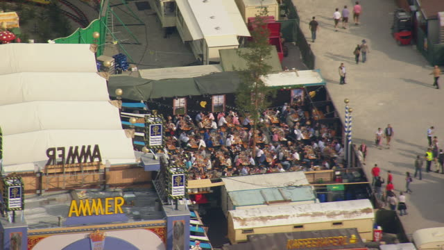 ms aerial shot of oktoberfest with crowded people / germany - western script stock videos & royalty-free footage