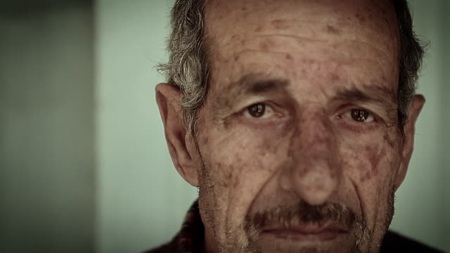 cu shot of old arab man / amman, jordan    - uomini anziani video stock e b–roll
