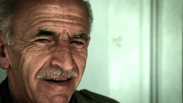 cu shot of  old arab man smiling / amman, jordan    - wrinkled stock videos and b-roll footage