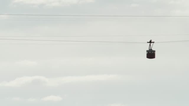 stockvideo's en b-roll-footage met ws la shot of old cable car moving to building / barcelona, catalunya, spain - kabelwagen