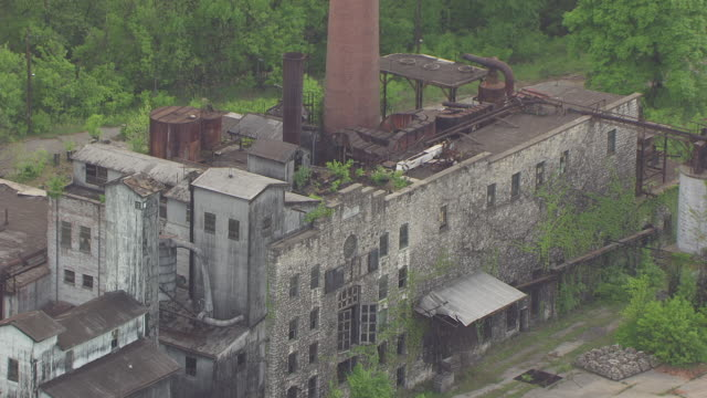 CU AERIAL ZO Shot of Old Crow Distilling Company stone sign and entire building and landscape / Kentucky, United States