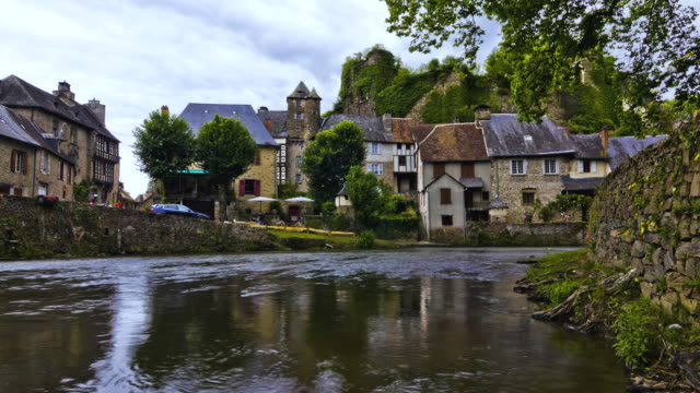 MS T/L Shot of old houses and castle with river / Segur-le-Chateau, Limousin, France