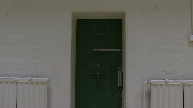 shot of old jail door - prisoner stock videos & royalty-free footage