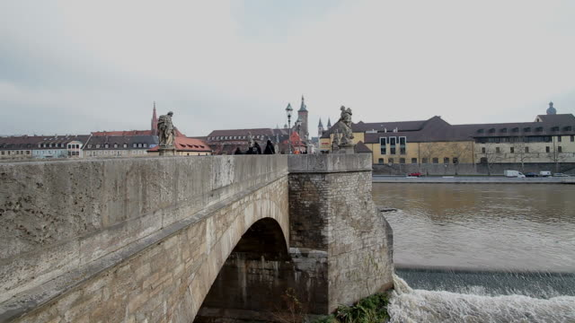 ws shot of old main bridge and river / wurzburg, bavaria, germany - wurzburg stock videos and b-roll footage