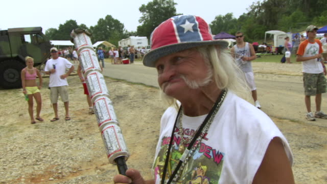 cu zi shot of old man making funny face with holding torch made of budweiser cans during summer redneck games / dublin, georgia, united states - grimacing stock videos & royalty-free footage