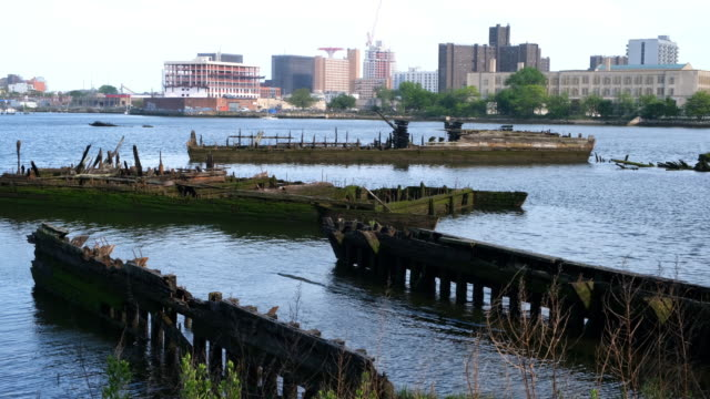 shot of old rotting piers during the daytime. - coney island brooklyn stock videos & royalty-free footage